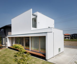 A White Box Family House With Unusual Connections Between Its Rooms
