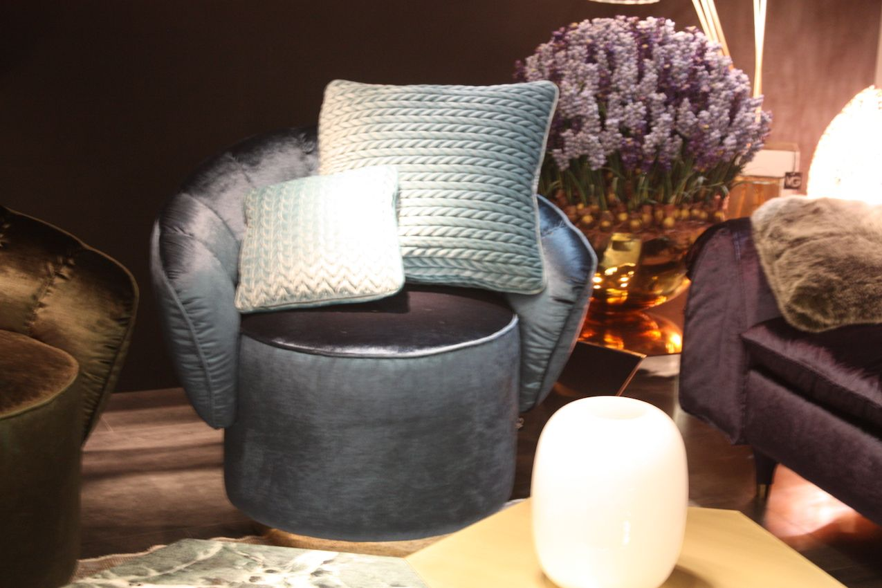 A bold chevron cushion would be at odds with the refined chair.