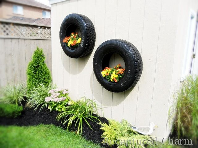 Wall old tires turned into planters