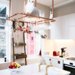 White kitchen white cabinets hanging planters
