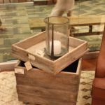 Adding rustic accessories like the metal-accented hurricane candle holder adds to the casual feeling.