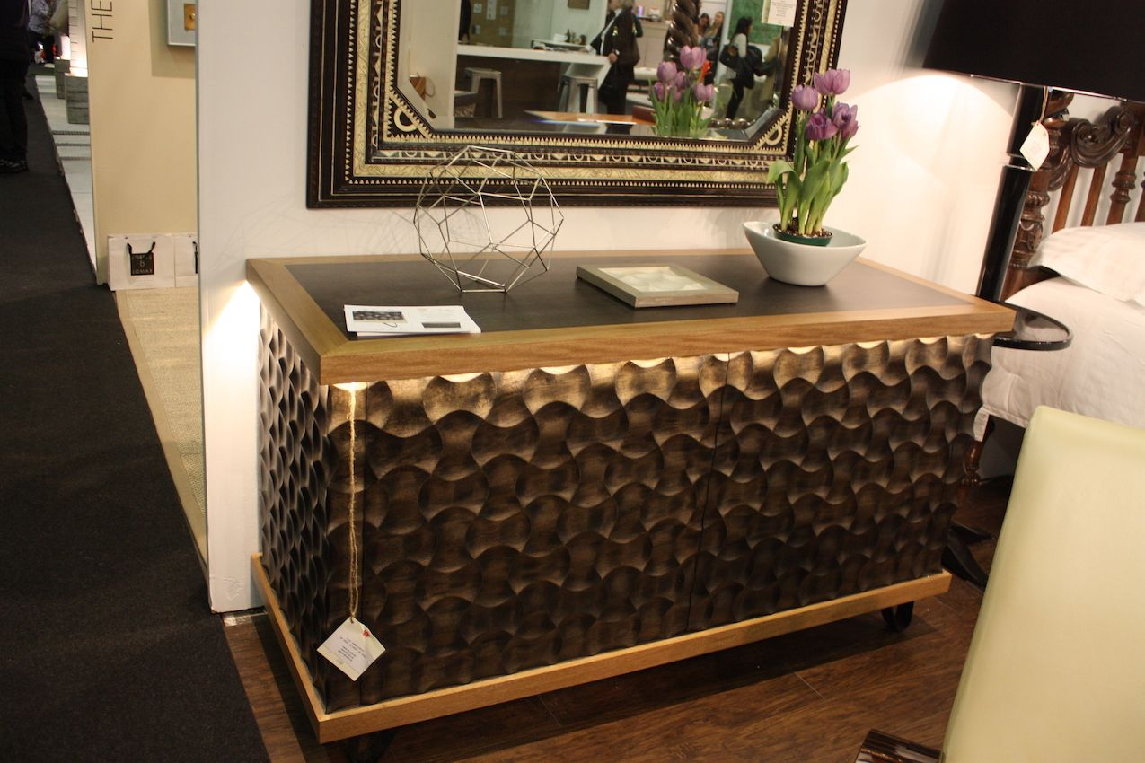 A carved surface with a geometric design is very textural.