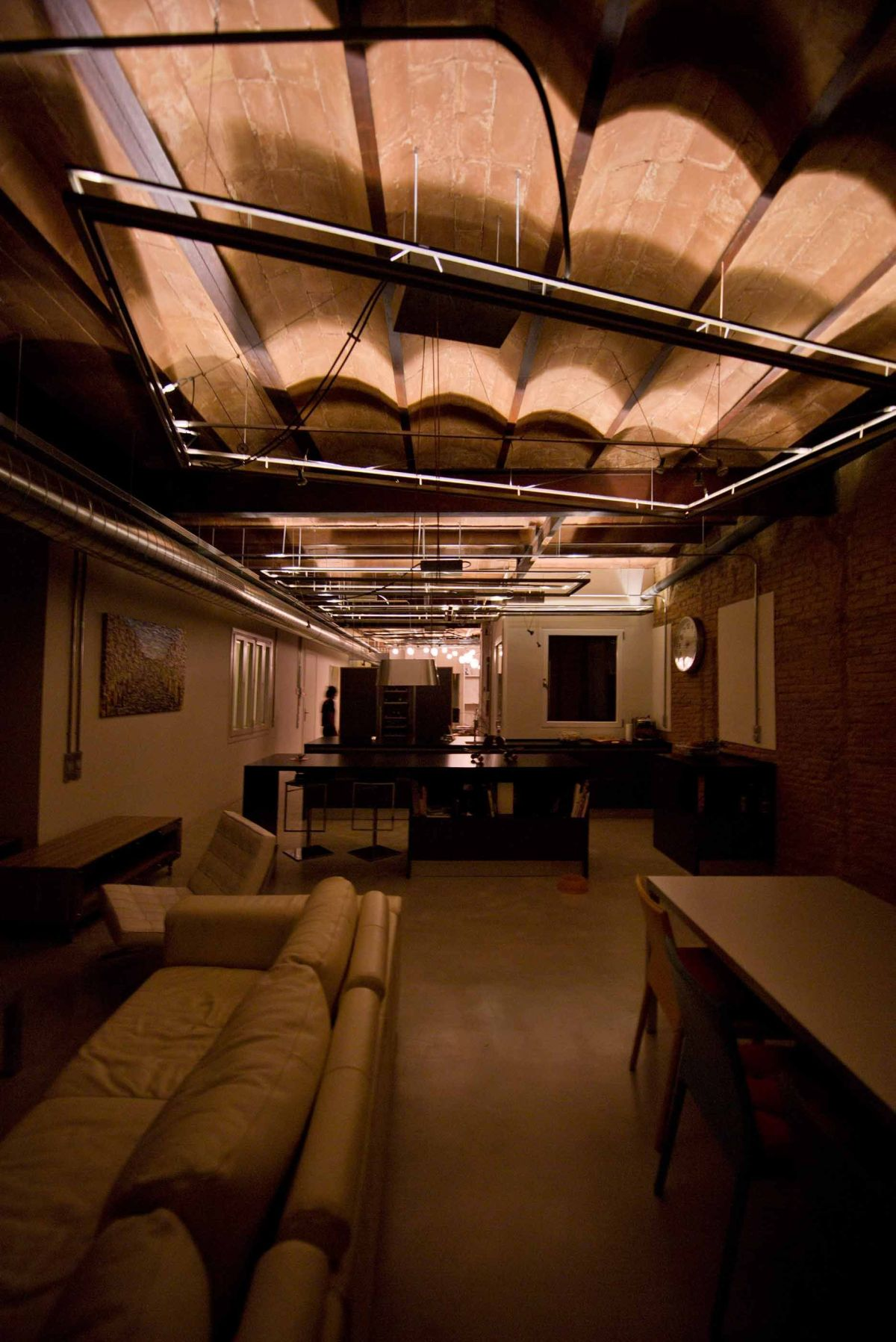 """This long view of the apartment highlights the ceiling and the effect of the """"lighting carpets."""""""