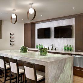 Chic basement bar TV backsplash marble counter