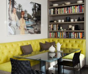 Contemporary breakfast nook with yellow tufted booth seat