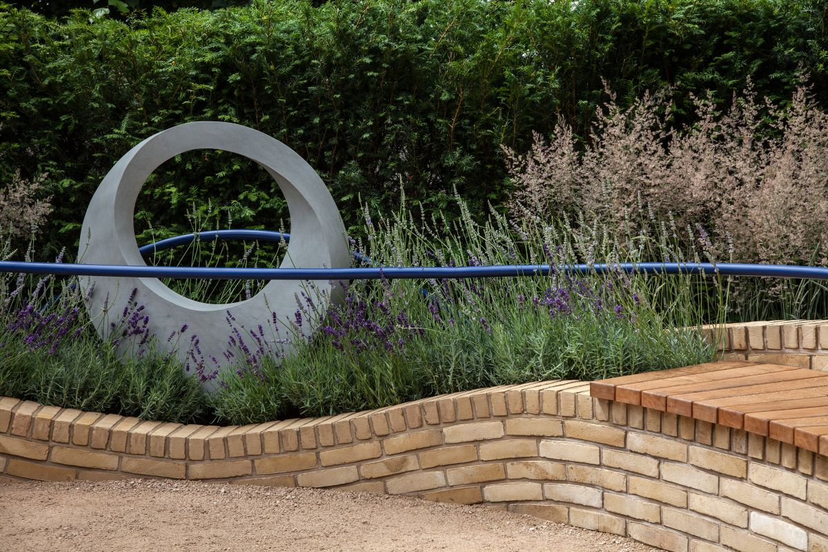 You can position the bench next to a garden sculpture or it can overlook something similar