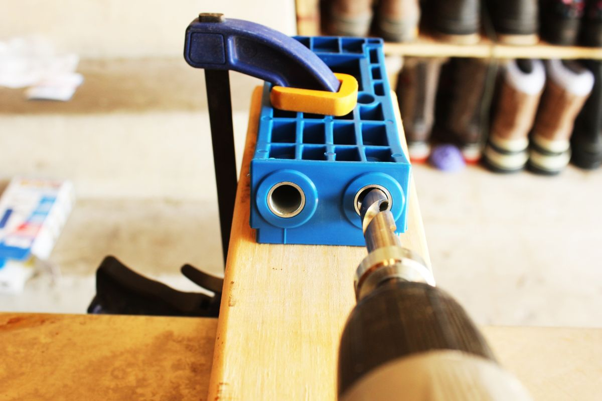 Drill into the two guide holes to create two pocket holes.