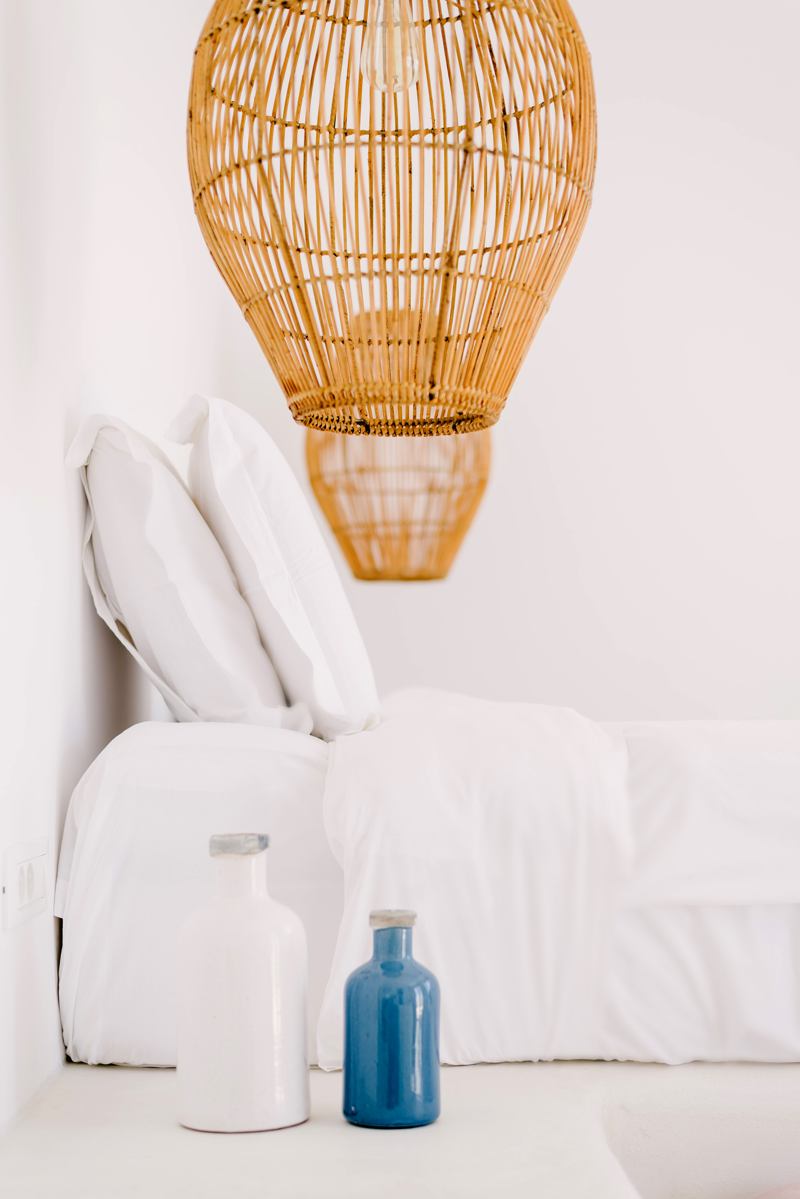 Generously sized light fixtures and small bottles work together well.