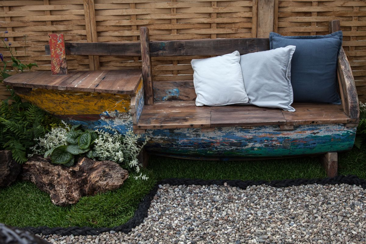 This is a unique bench that was built out of a repurposed old boat