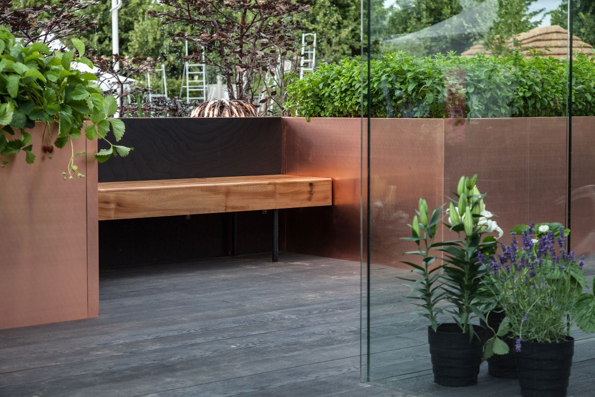 If you prefer a bit of privacy, the bench can be placed in a nook or can be framed by large planters