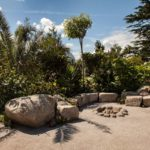 How to use large boulders to create a natural garden seating around fire pit