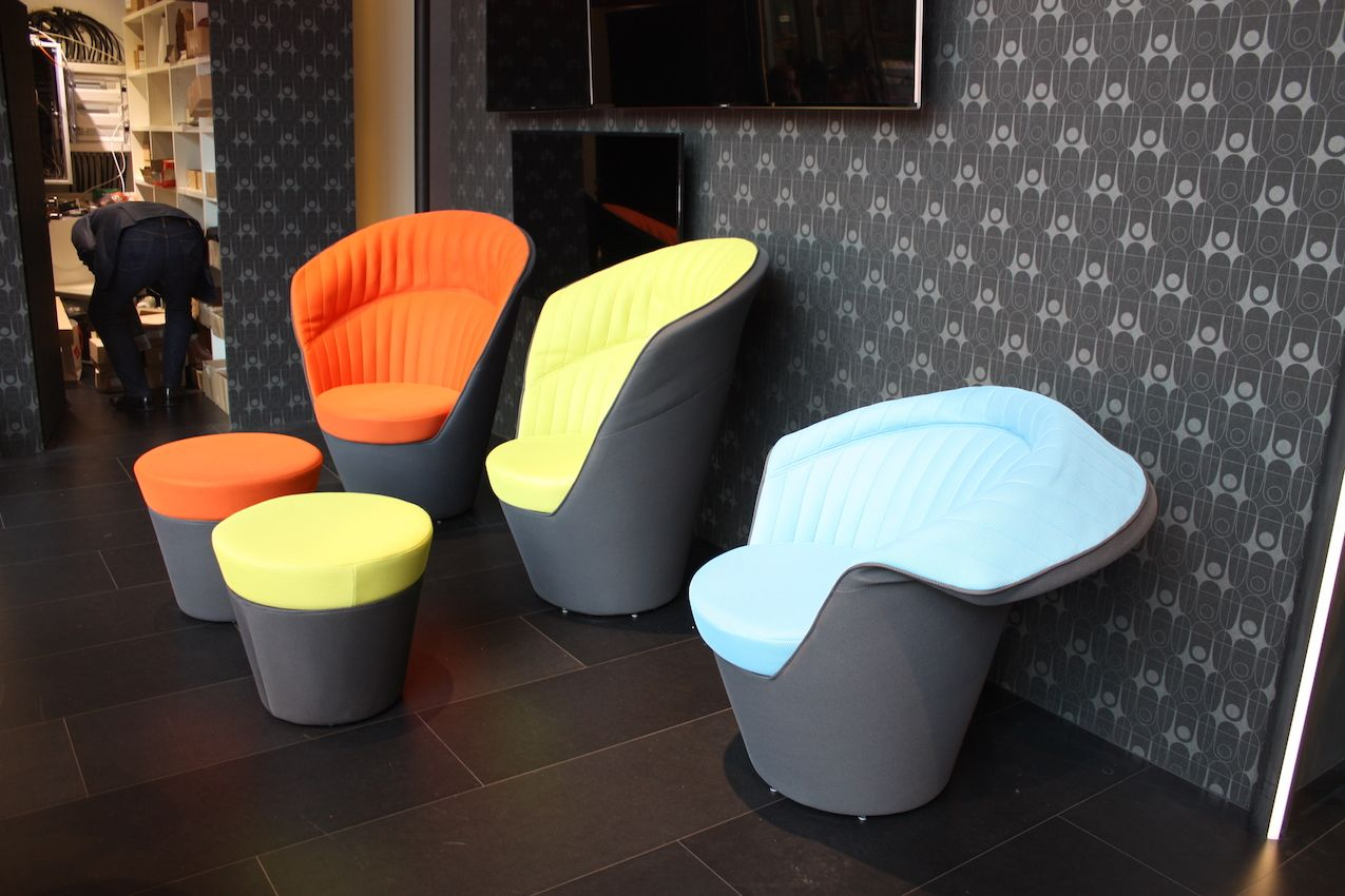The chairs swivel and the matching stools have storage.