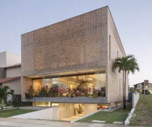 A Residence With A Perforated Brick Facade And A Dual Nature