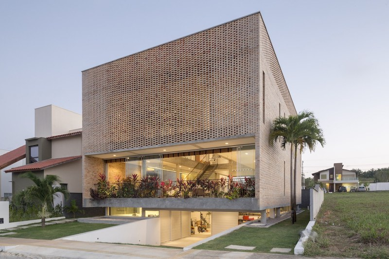 A Residence With Perforated Brick Facade And Dual Nature