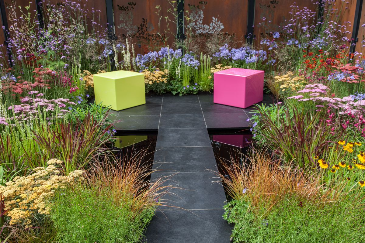 A water feature such as a small pond can be quite relaxing to look at and a bench can really help with that