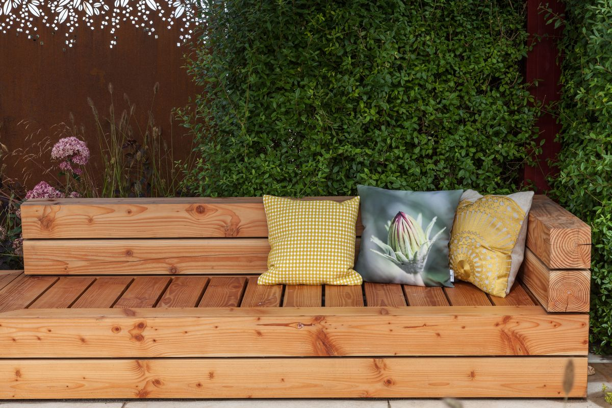 A garden bench can be built out of various different materials and wood is a pretty common option
