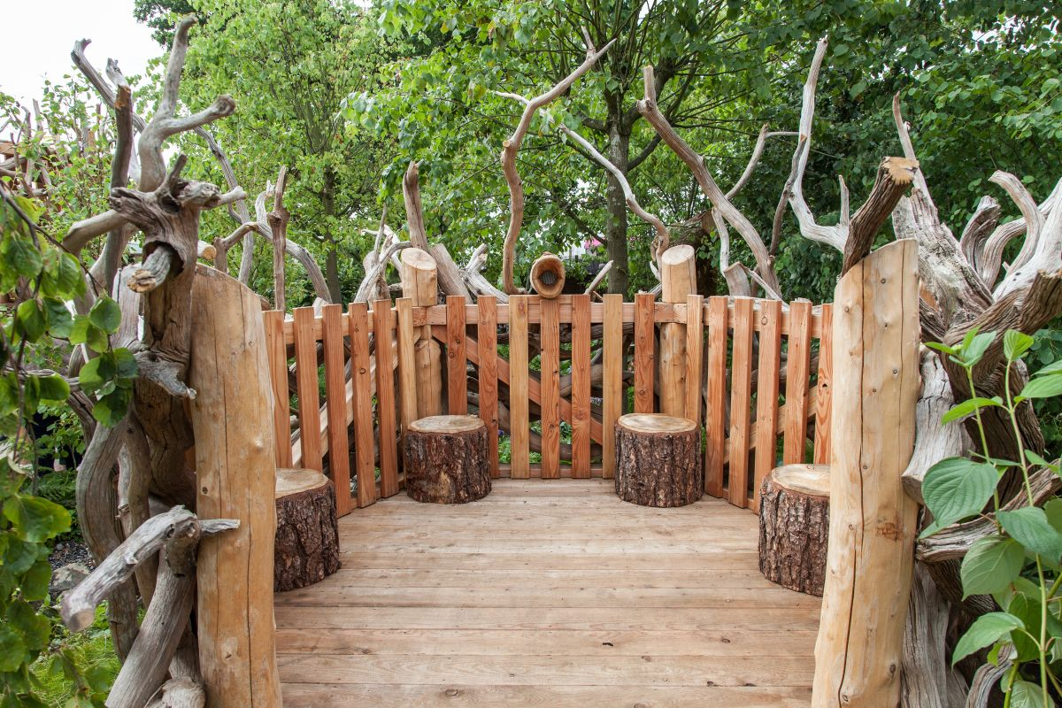 You can repurpose tree stumps as stools and fallen tree trunks can be used as fence poles or decorations