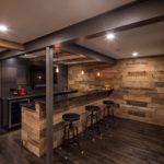 Rustic basement bar steel beams wood wall