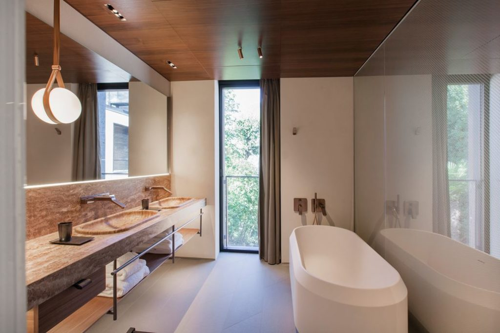 Uncluttered and modern, the bathroom is a haven of calm.