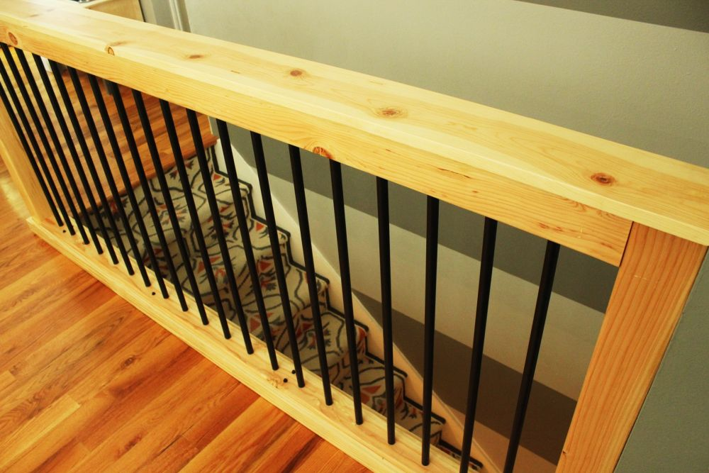 The contrast of the black spindles of this stair railing and the blonde wood is striking