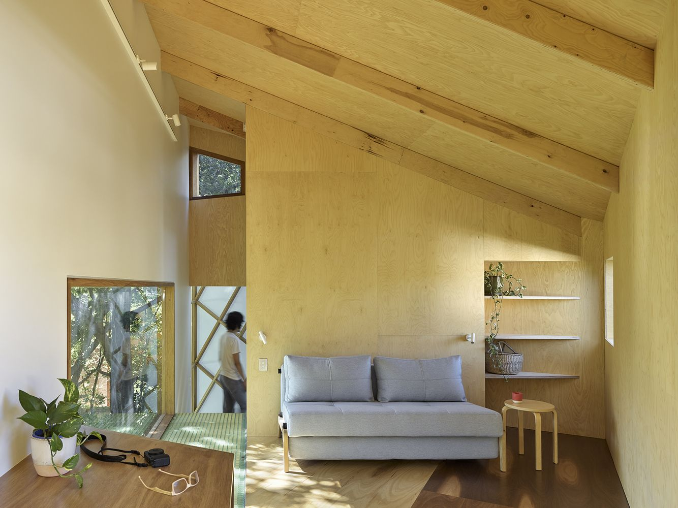 The interior is very simple, reminiscent of a child's treehouse