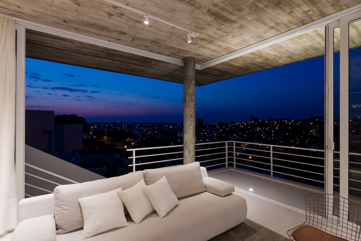 Sliding glass doors open up the social areas and expose them to the panoramic views