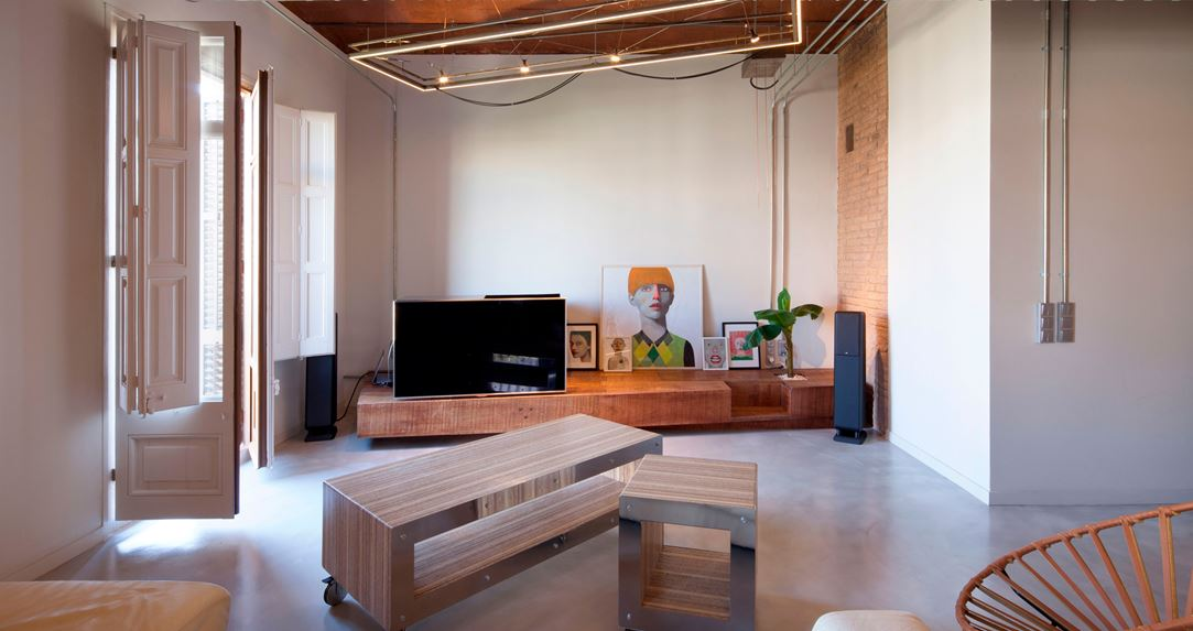 The shelf that holds the TV is very adaptable to multiple uses, including as seating.