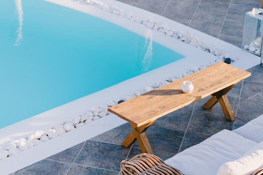 Furnishings around the pool have the same natural characteristics as throughout the rest of the property,