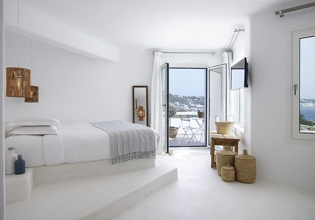 Natural fabrics cover all the beds.