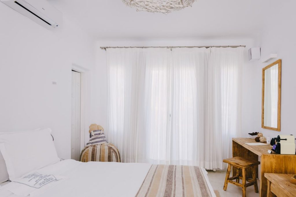 Sheer drapes offer privacy without cutting out too much natural light.