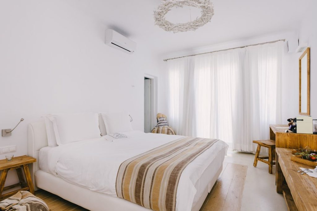 The separate bedroom offers the same amenities and natural decor.