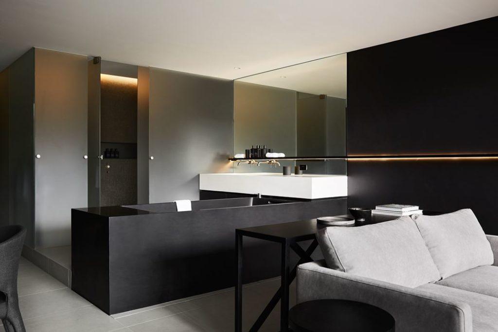 Bathroom fixtures are major design elements in the room.