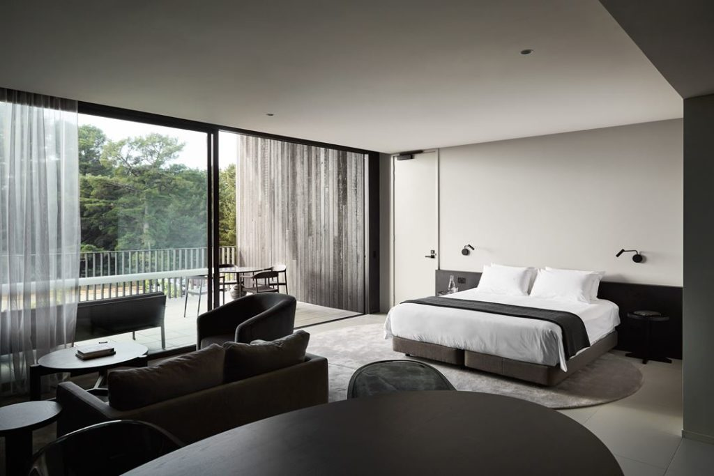 The bed faces the roomy private terrace.