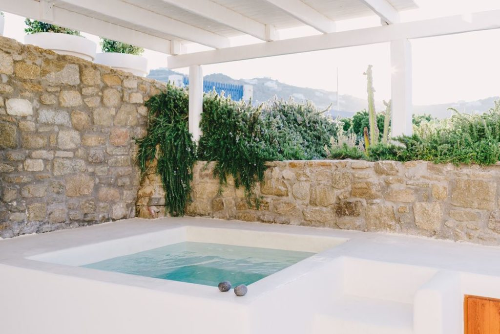 Plants and stone walls help ensure privacy.