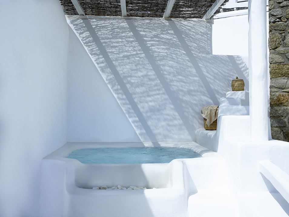 This private tub has a rustic, thatched cover to shade the area.
