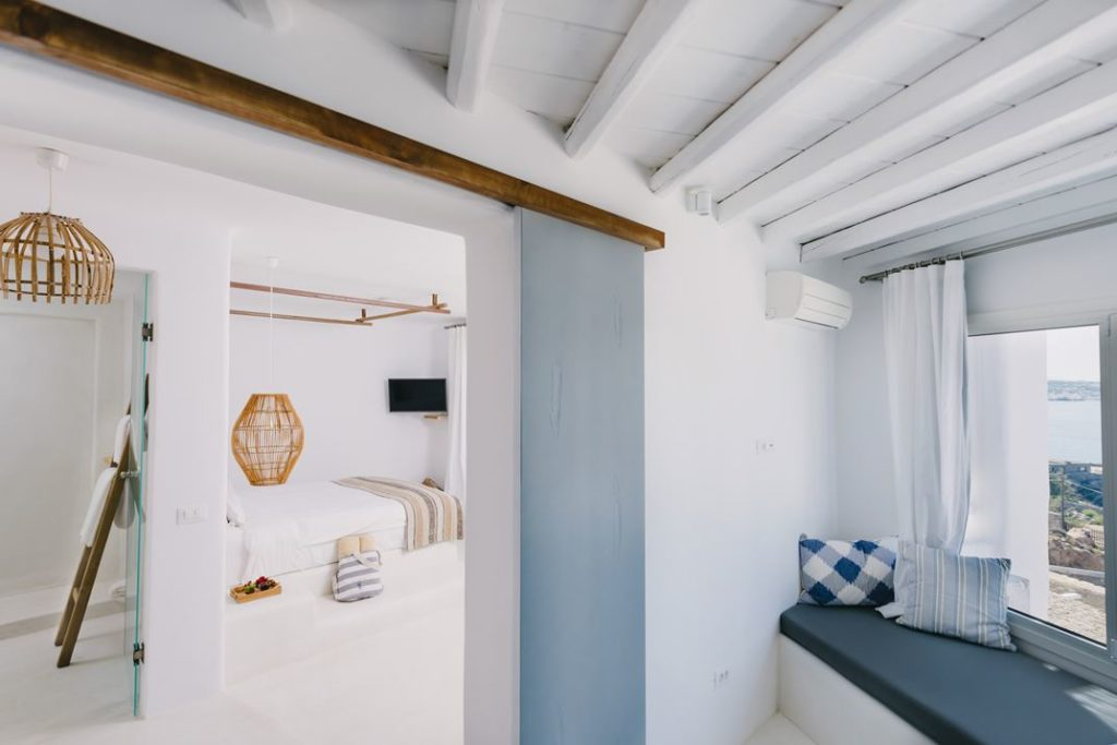The bedrooms have a rolling barn door to keep the space uncluttered.