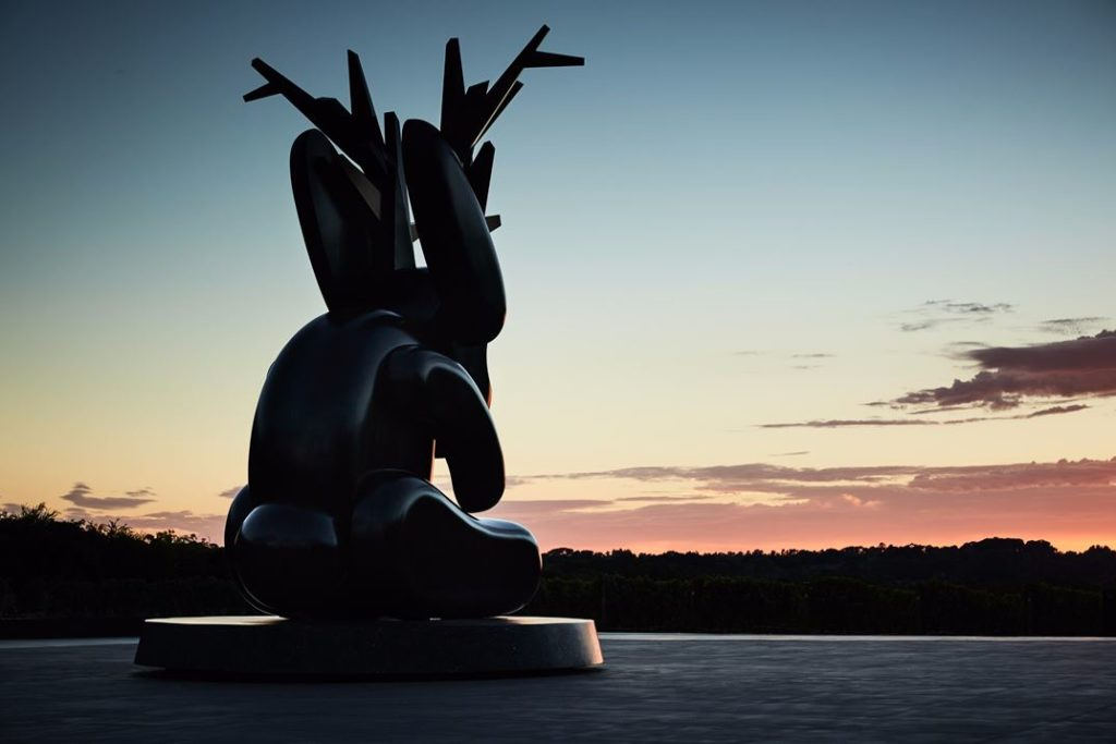 The sculpture fits well with the surrounding dramatic landscapes.