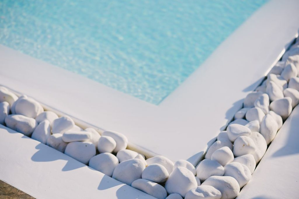 The white stone border is a natural poolside accent.