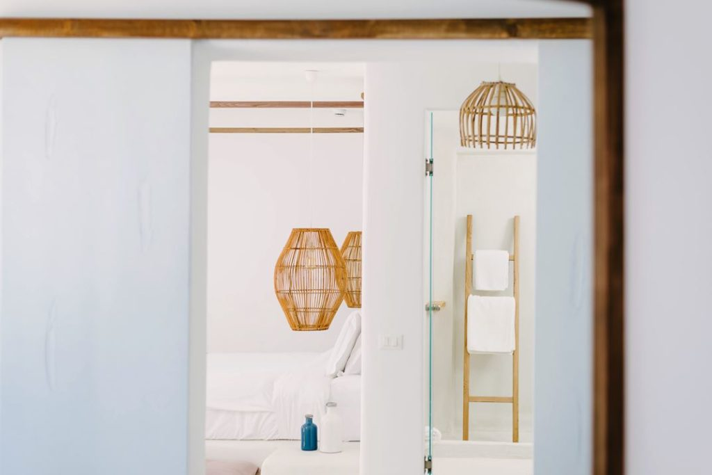 The same style of wooden light fixture is repeated in the bathroom.