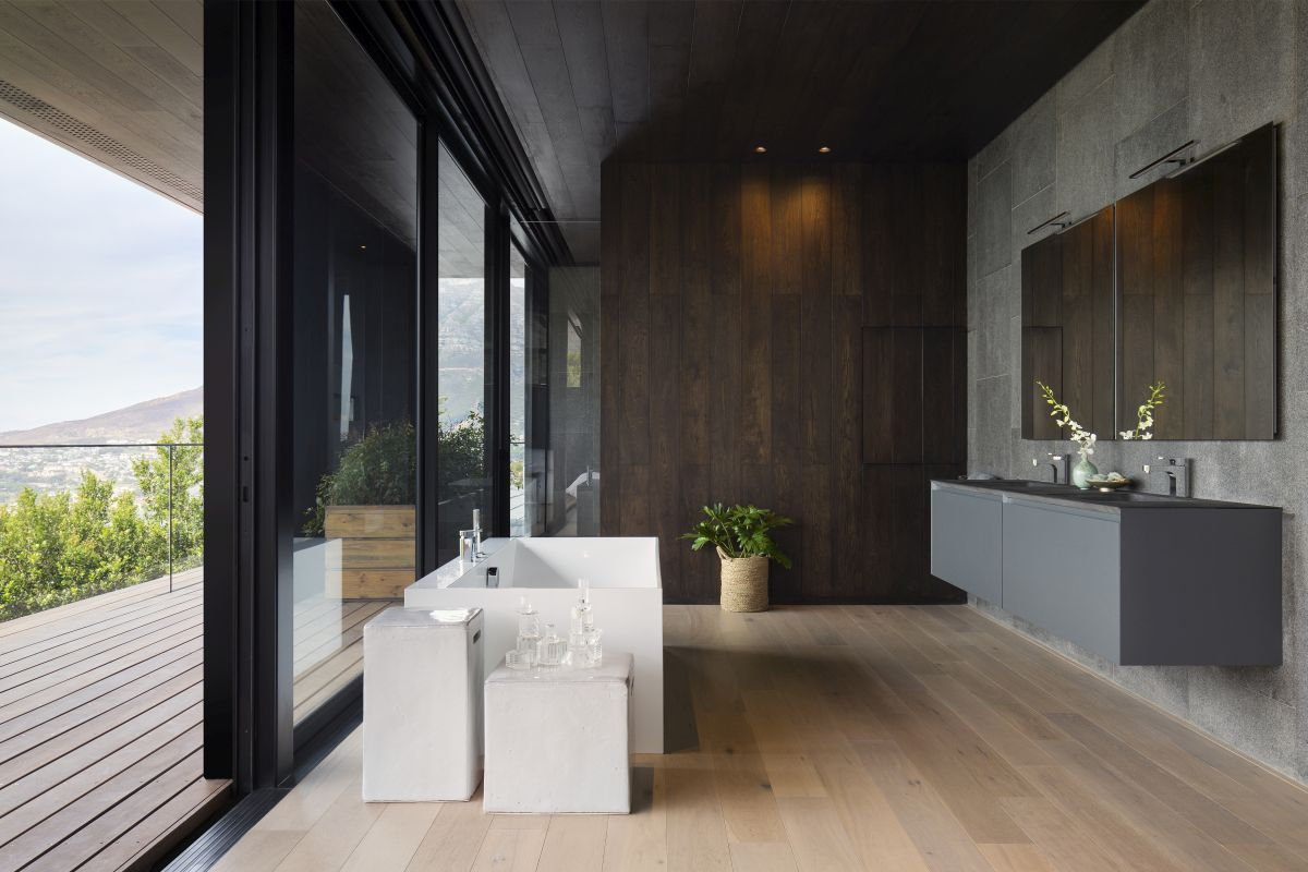 It too has access to the terrace and large windows that let in the light and the view