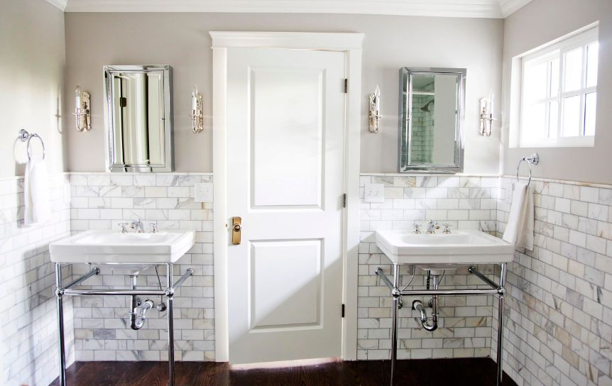 In the bathroom, marble subway tiles add an unexpected touch of sophistication and luxury