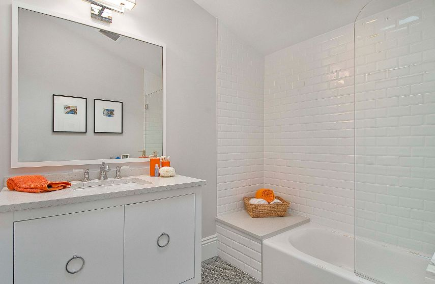 In bathrooms, beveled tiles maintain a simple look without being monotonous
