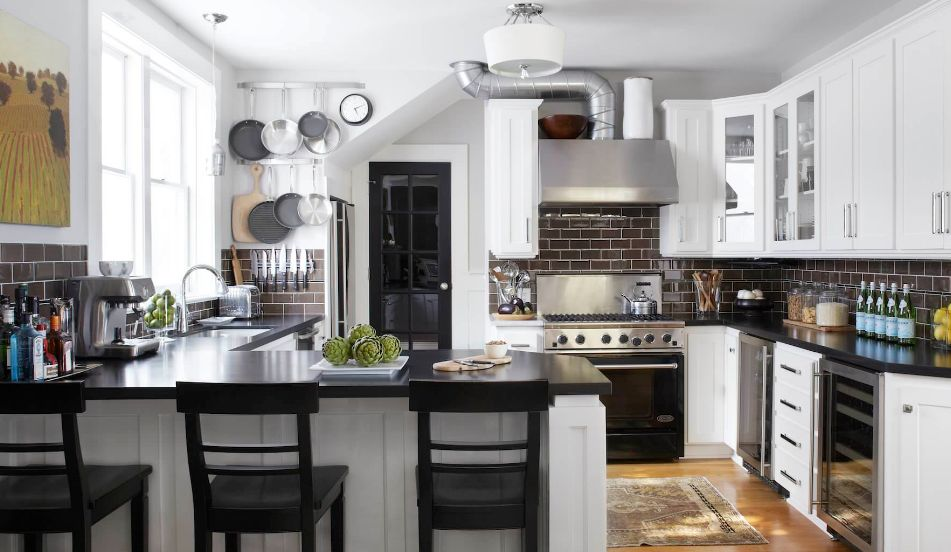 Complement a black subway tile backsplash with black appliances, countertops or furniture accents