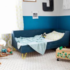 Blue toddler bed with yellow hairpin legs
