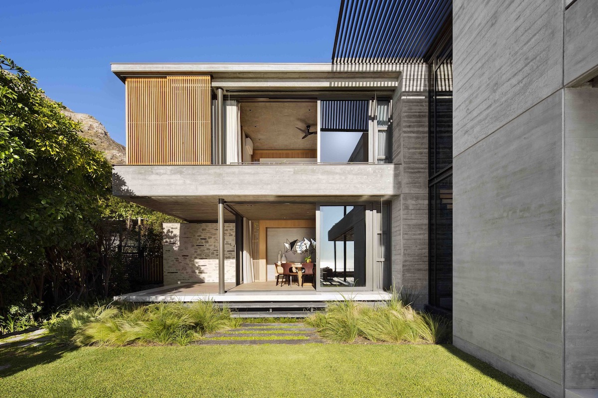 The interior is organized into three blocks, each with its own connection to the outdoors