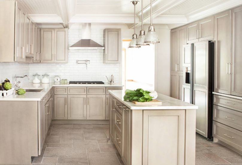 Pair a white subway tile backsplash with cabinetry in a light color to make a kitchen look more spacious