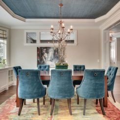 Dining room with a traditional design wallpaper texture tray ceiling