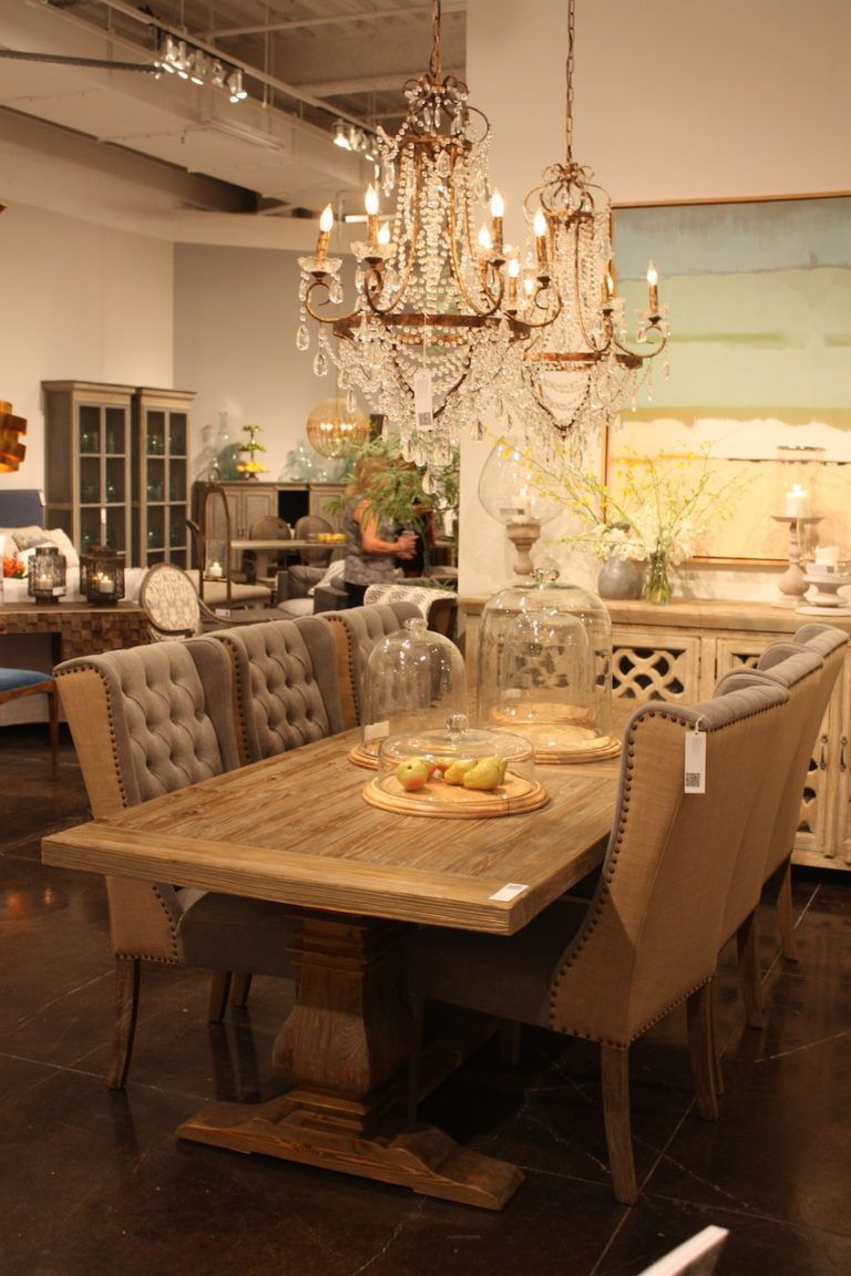 The traditional vibe is softened by the shabby chic chandelier.