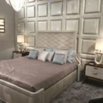 Luxury grey bed frame with wall paneled behind
