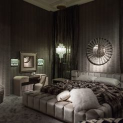 Luxury monochromatic grey room with a platform velvet bed